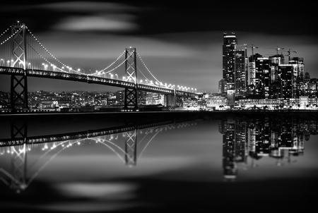 Foto de The San Francisco Bay at Night in Black and White. Bay Bridge and San Francisco Skyline. Monochrome. - Imagen libre de derechos