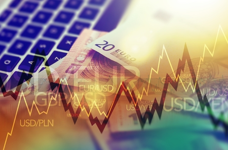 Photo pour Trading Markets. Forex Currency Trading Concept with Computer, Cash Euro Money and Some Line Graph Statistics. - image libre de droit
