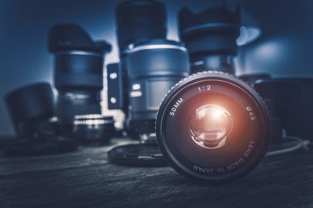 Foto de Camera Lens and Photography Equipment in the Background. Photography Concept Photo. - Imagen libre de derechos