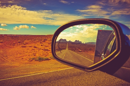 Photo pour Travel Trailer Road Trip in Arizona. Looking Back and Saying Good Bye to the Famous Monuments Valley. - image libre de droit