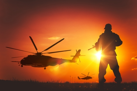 Photo for Military Mission at Sunset. Marines Helicopters Air Mission. Soldier with Assault Rifle Cover the Area. - Royalty Free Image