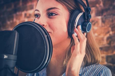 Photo for Woman Recording Audiobook. Audio Recording Studio Theme. Caucasian Voice Talent. - Royalty Free Image