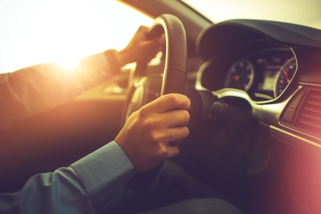 Photo for Car and the Driver. Summer Sunset Trip. Modern Car Interior. - Royalty Free Image
