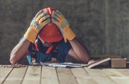 Photo pour Disappointed Sad Caucasian Contractor Worker Facing Legal Problems. Bond, Insurance, Work Injury Concept Photo. - image libre de droit