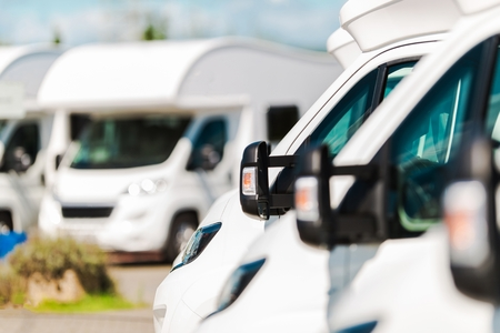Photo pour RV Campers For Sale in the RV Dealership. Brand New Motorcoaches. Travel and Tourism Industry. - image libre de droit