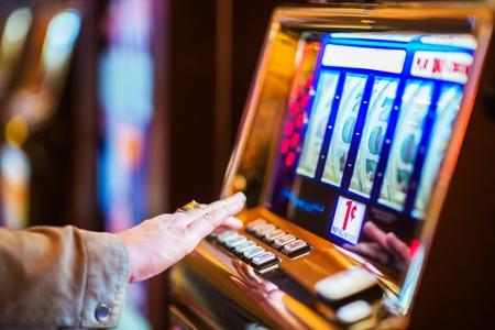 Foto de Casino Gambling Industry Theme. Caucasian Woman Playing Classic Slot Machine in the Casino. - Imagen libre de derechos