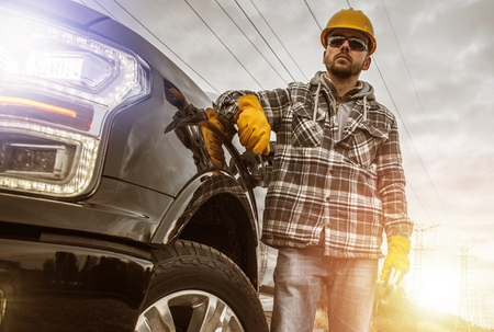 Photo pour Caucasian Contractor in His 30s and His Modern Heavy Duty Pickup Truck For Heavy Loads. - image libre de droit