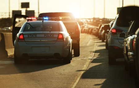 Photo for Police Traffic Stop. Policeman Stop Speeding Vehicle on the Side of the Highway. Chicago, Illinois, USA. - Royalty Free Image