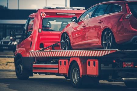 Photo pour Red Broken Car on a Red Towing Truck. Closeup Photo. Vehicle Mechanical Problem on the Road. - image libre de droit