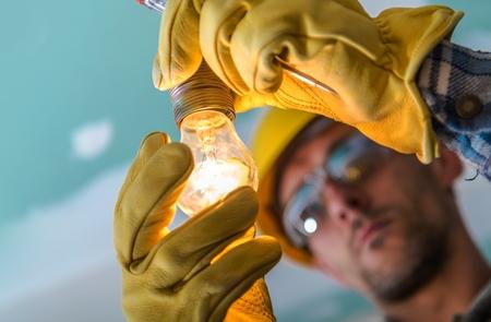 Foto de Professional Electric Light Point Installing. Construction Industry Theme. Closeup Photo. - Imagen libre de derechos