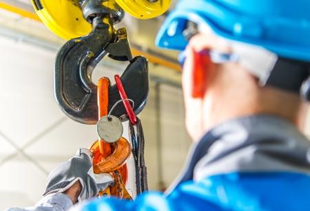 Photo pour Caucasian Lifting Crane Operator and His Job. Modern Warehouse Equipment. - image libre de droit