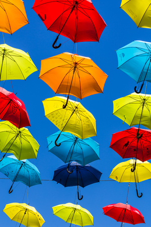 Foto de Two hundred colourful umbrellas suspended above a street in Liverpool city centre to raise awareness about ADHT. - Imagen libre de derechos