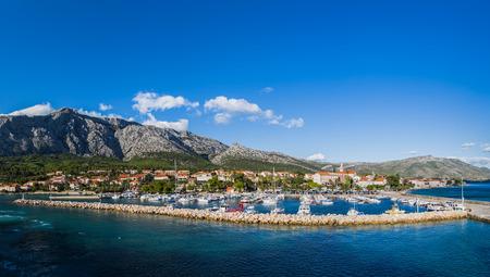 Photo for A multiple image panorama of Orebic marina seen at the foot of Mt Ilja (Mount Elijah) - the highest peak on the Peljesac Peninsula in Croatia. - Royalty Free Image