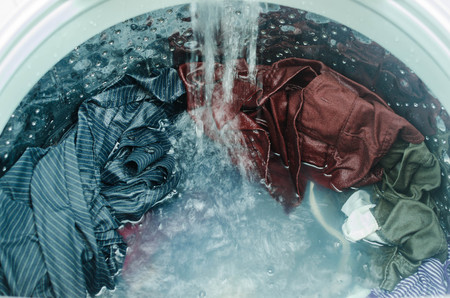 Photo pour Clothes in washing machine - image libre de droit
