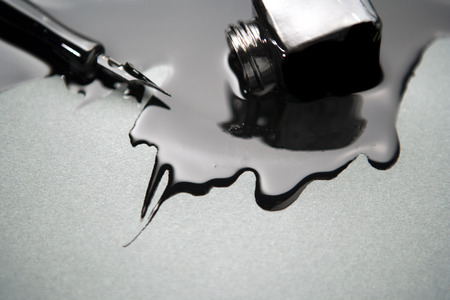 Photo for old fashioned pen with a glass of spilled black ink - Royalty Free Image