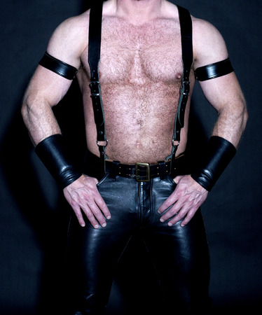 Foto de hairy muscular male torso dressed in fetish black leather - Imagen libre de derechos
