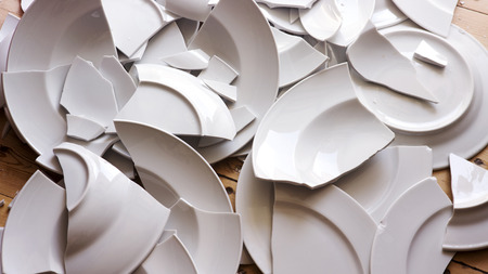 Photo for many white broken plates on a wooden floor - Royalty Free Image