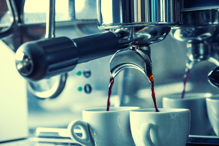 Preparation of two espresso in coffee machines.Professional coffee machine making espresso in a Two cafe.