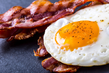 Photo for Ham and Egg. Bacon and Egg. Salted egg and sprinkled with black pepper. English breakfast. - Royalty Free Image