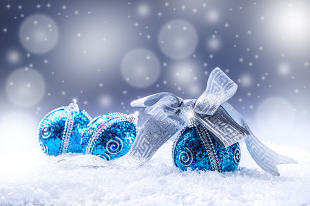 Photo pour Christmas.Christmas blue balls and silver ribbon snow and space abstract background. - image libre de droit