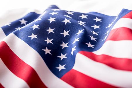 Foto de USA flag. American flag. American flag blowing wind. Close-up. Studio shot. - Imagen libre de derechos