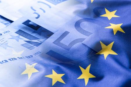 Photo pour Euro flag. Euro money. Euro currency. Colorful waving european union flag on a euro money background. - image libre de droit