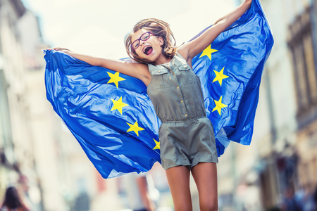 Photo for EU Flag. Cute happy girl with the flag of the European Union. Young teenage girl waving with the European Union flag in the city. - Royalty Free Image