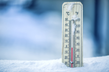 Photo for Thermometer on snow shows low temperatures - zero. Low temperatures in degrees Celsius and fahrenheit. Cold winter weather - zero celsius thirty two farenheit. - Royalty Free Image