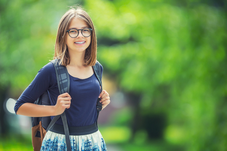 Photo pour Portrait of attractive young teenage school girl with backpack. - image libre de droit