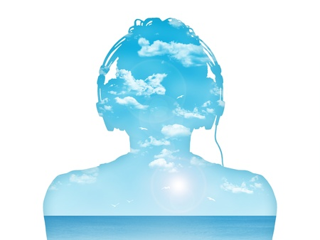 Photo for silhouette of a man in headphones listening to the music, nice blue sea landcape inside him - Royalty Free Image