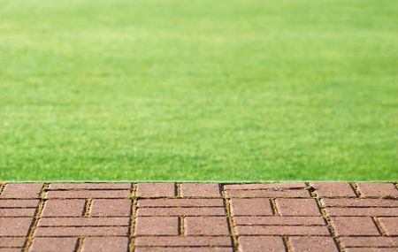 flat green lawn and block paved step abstract
