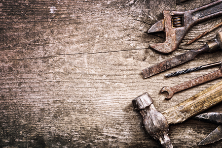 Foto de Dirty set of hand tools on a wooden background .  vintage photo - Imagen libre de derechos