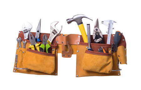Foto de Tool belt with tools isolated on white background - Imagen libre de derechos