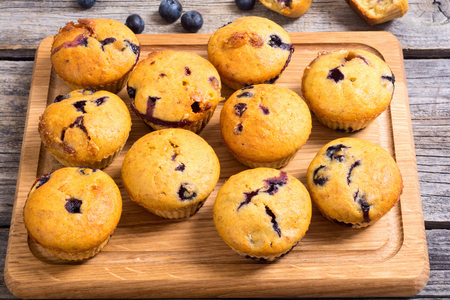 Photo for Banana muffins with blueberry on rustic background . - Royalty Free Image