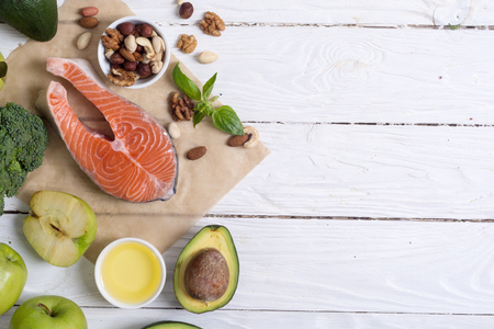 Photo pour Healthy food vegetables , nuts and salmon . With vitamin omega 3 - image libre de droit