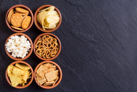 Photo for Frame . Mix of snacks : pretzels , crackers , chips , pop corn and nachos - Royalty Free Image