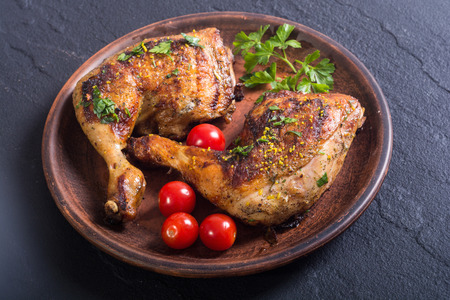 Photo for Grilled chicken legs with tomatoes and parsley - Royalty Free Image