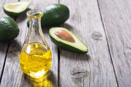 Photo for Fresh healthy green avocado and oil . With space for text - Royalty Free Image