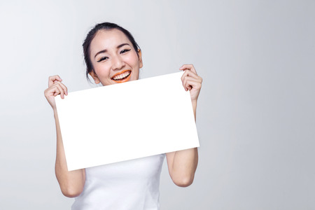Photo for Beauty woman portrait. Skin and face care concept holding white signage with free copyspace for your text on white background - Royalty Free Image