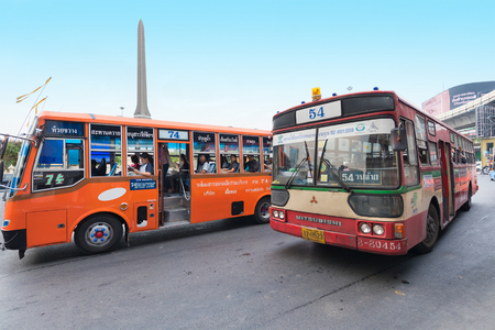 Photo for BANGKOK - DECEMBER 15, 2015: Public buses move by the Victory Monument bus stop. Transport in Thailand is varied and chaotic, with no one dominant means of transport. - Royalty Free Image