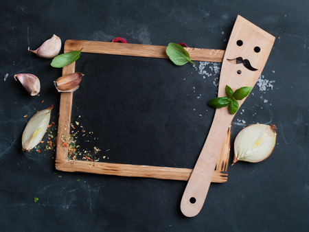 Vintage chalk board with spatula and spice, selective focus.  Cooking concept