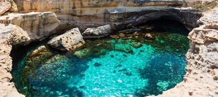 Foto de Picturesque seascape with white rocky cliffs, caves, sea bay and islets at Grotta della poesia, Roca Vecchia, Salento Adriatic sea coast, Puglia, Italy - Imagen libre de derechos