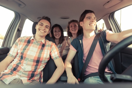 Photo for Four Friends in a Car Leaving For Vacation - Royalty Free Image
