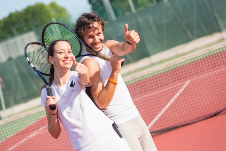 Two Happy Tennis Players with Thumbs Up