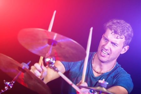 Photo for Young Man Playing Drums - Royalty Free Image