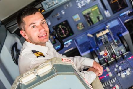 Photo pour Young Pilot in the Airplane Cockpit - image libre de droit