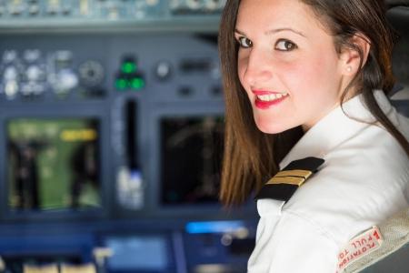 Photo pour Female Pilot in the Airplane Cockpit - image libre de droit