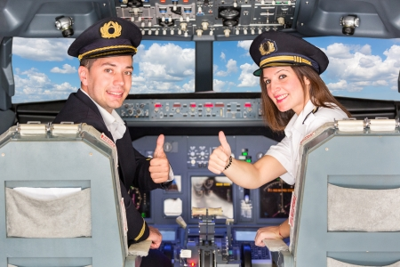 Photo pour Happy Pilots in the Cockpit with Thumbs Up - image libre de droit