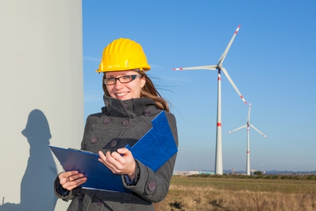 Photo for Female Engineer in a Wind Turbines Farm - Royalty Free Image