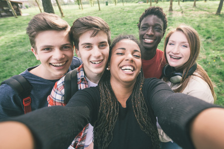 Photo pour Group of Multiethnic Teenagers Taking a Selfie - image libre de droit